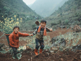 2 Hmong babies picked up the dirt