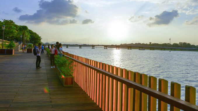 Check in Hue ironwood pedestrian bridge on the banks of the Perfume River -  Vietnam Tourism
